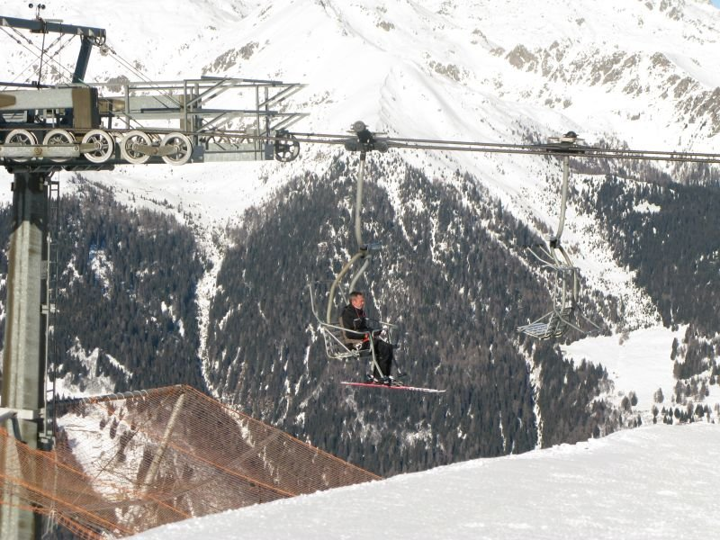 Rider on the chairlift at Pinzolo, Italy