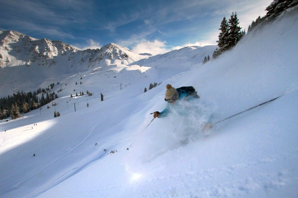A skier getting first tracks on slalom slope, Arapahoe Basin.