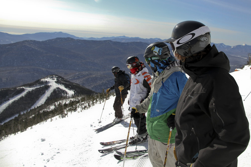 Group looks out over whiteface - © Whiteface Mountain Resort