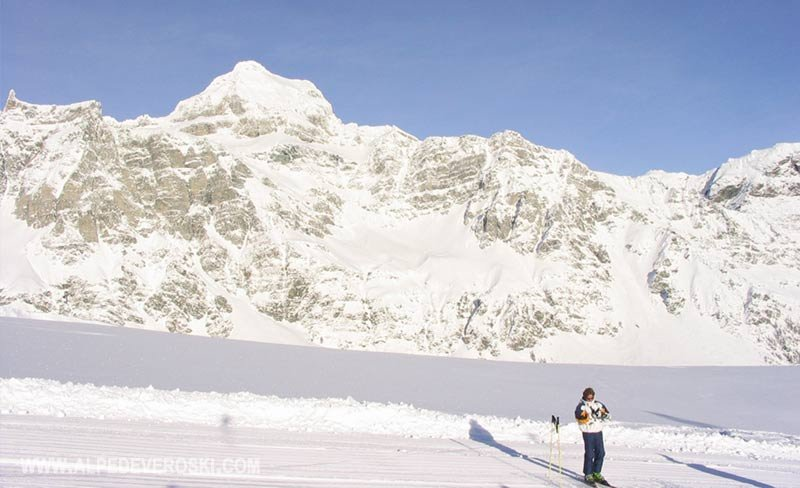 Skier on track at Alpe Devero Ski against a mountain backdrop