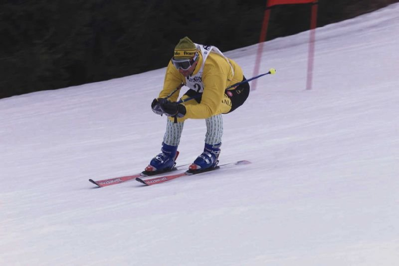 Skier racing down the slopes in Andalo