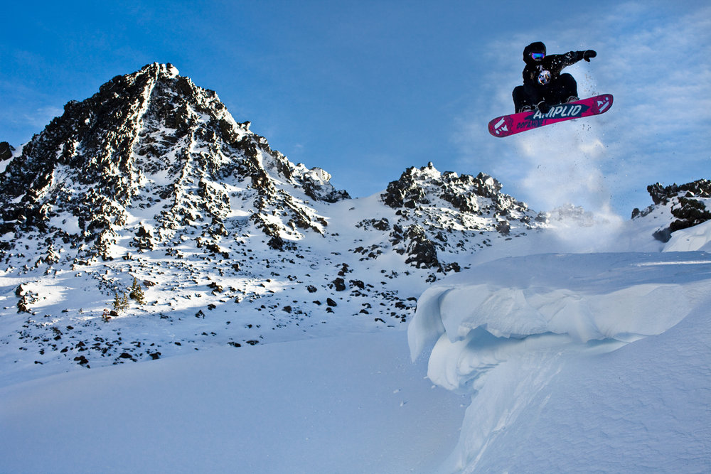 A snowboarder grabs cornice air at Mt. Bachelor.  - © Tyler Roemer