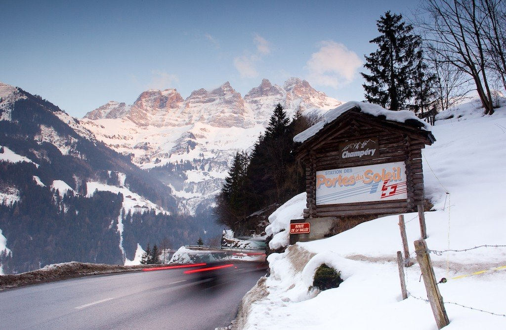 "A view of the road going up to Champery. Champery is the last village at the end of the Vallee d'Illiez and at the base of the iconic Dents du Midi. Translated to the ""Half Teeth"" (the mountains in the background). There are 7 peaks, each referred to as a ""tooth""."