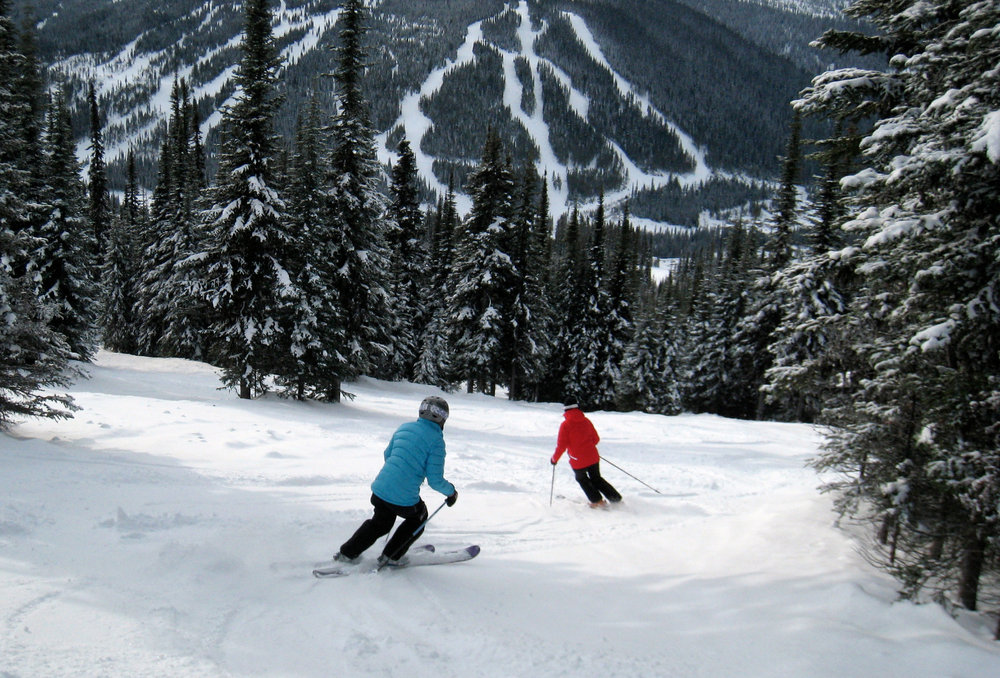 Skiers can try to keep up with Nancy Greene (in red) at Sun Peaks.  - © Becky Lomax
