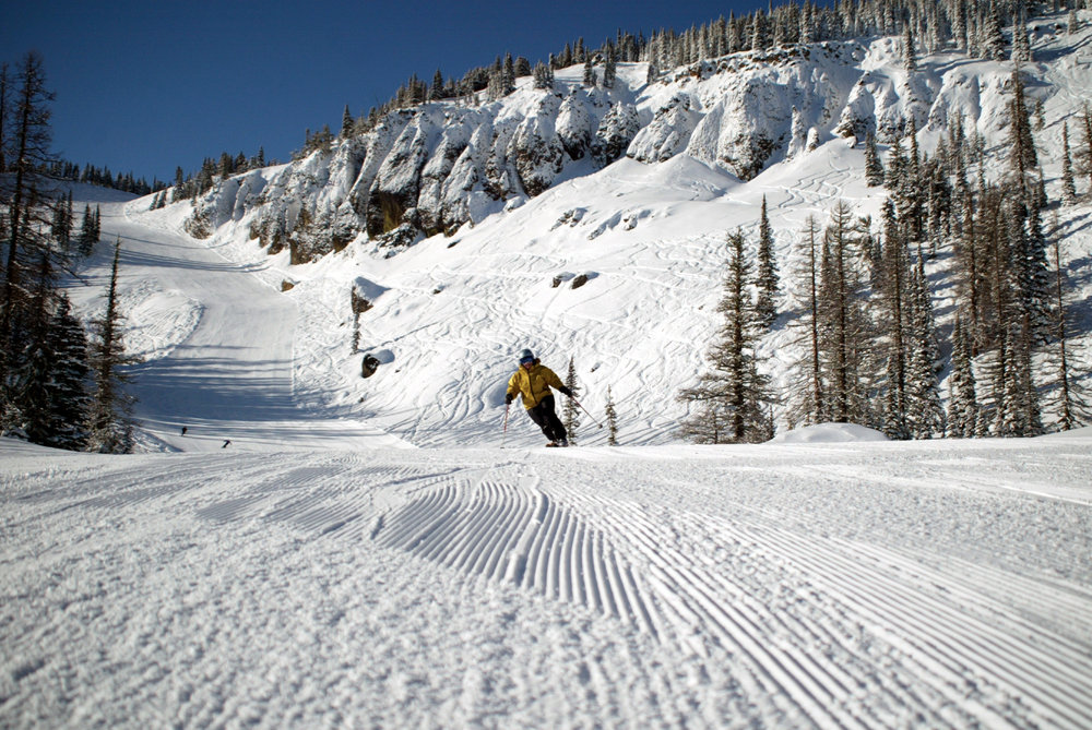 A skier catches corduroy down Mission Ridge's Bomber Bowl.  - © Mission Ridge