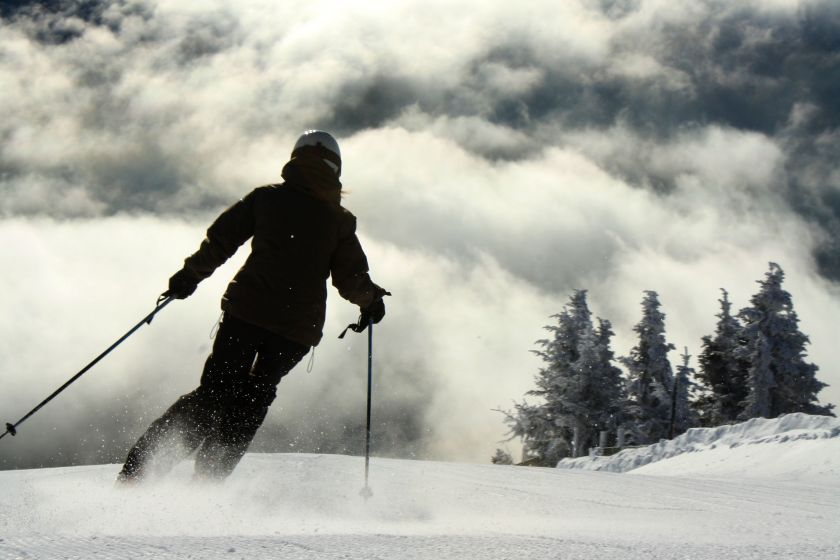 A skier carves turns above the cloud line. Photo courtesy of Jay Peak Resort.