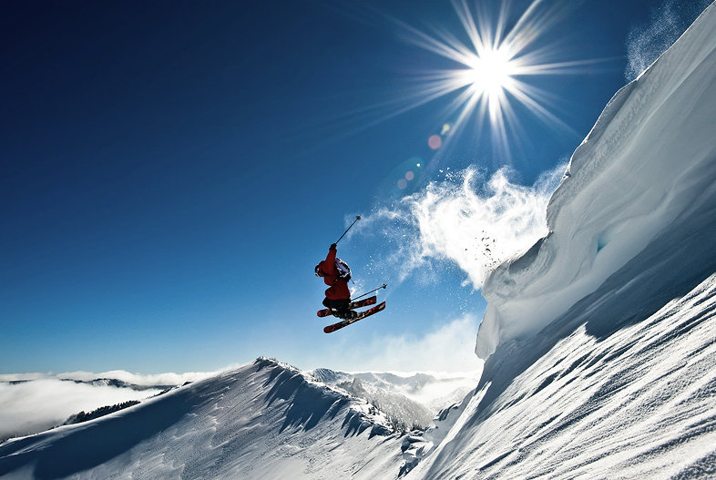 Pro skier Andy Mahre leaps a cornice at White Pass.  - © Jason Hummel