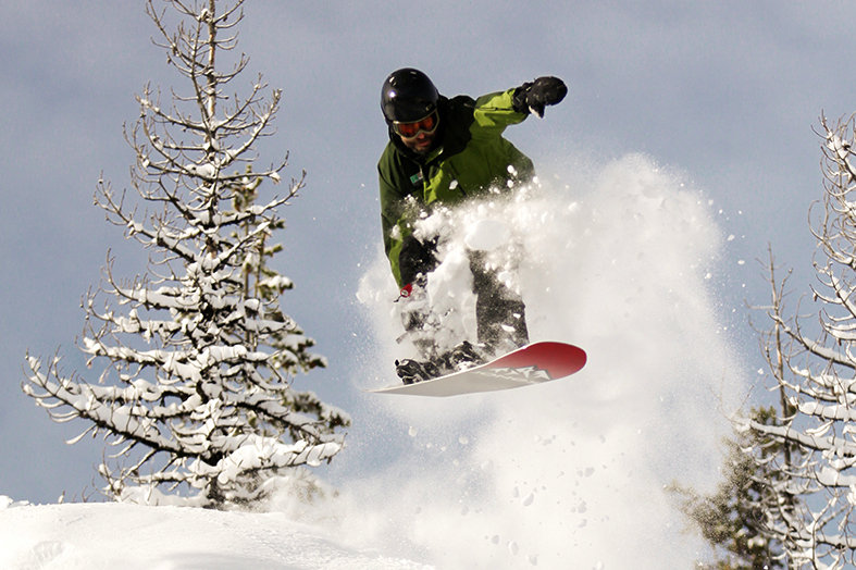A snowboarder flies through powder at Hoodoo. Photo courtesy of Hoodoo Ski Area.