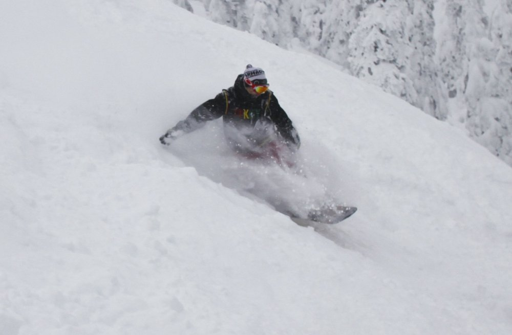 A snowboarder in powder on opening day at Whitefish. Photo courtesy of Whitefish Mountain Resort. - © Whitefish Mountain Resort