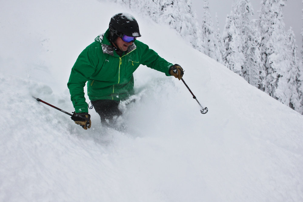 A skier sinks into powder at Whitefish Mountain Resort. - © Whitefish Mountain Resort