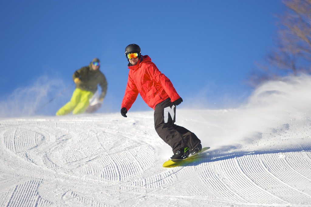 A skier and snowboarder getting fresh tracks. Photo Courtesy of Mount Snow.