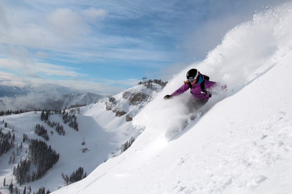 A snowboarder in Jackson Hole powder.  - ©Jackson Hole Mountain Resort