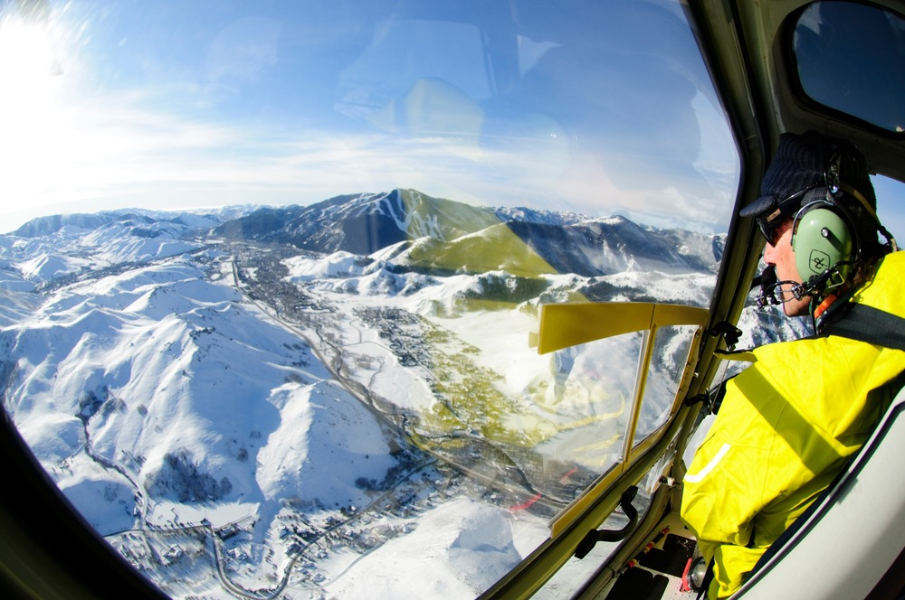 High above the Sawtooths, with Sun Valley in the distance. - © Tal Roberts
