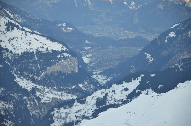 The view from the highest train station in Europe looks down at the start of the Downhill course, the town of Wengen on the ridge and the town of Interlaken over 10,000 vertical feet below. - © Travis Ganong