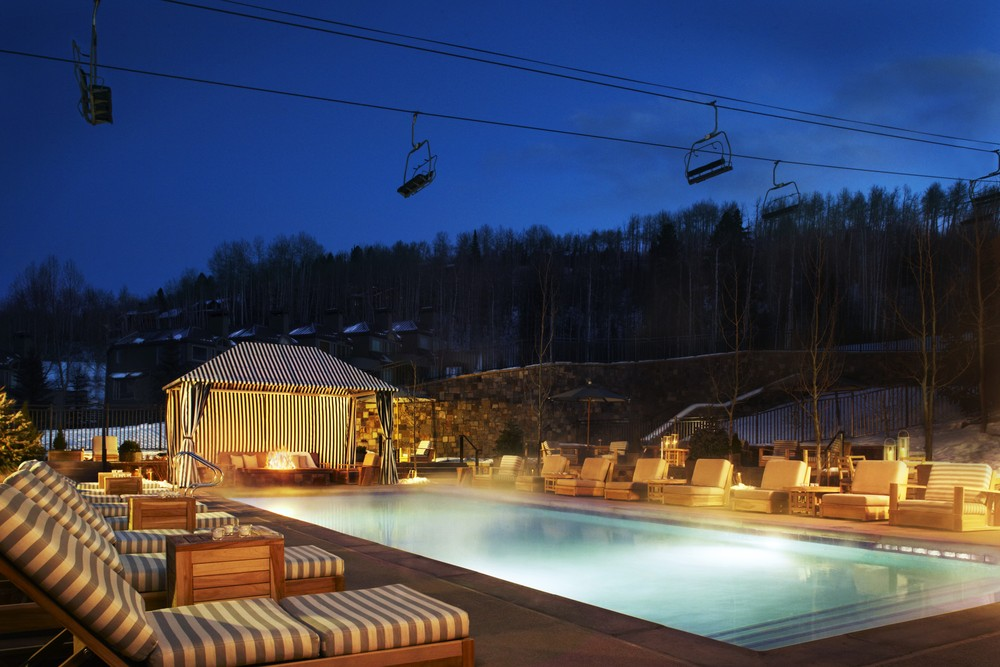 The slopeside terrace features a state-of-the-art pool, two oversized hot tubs, private cabanas and numerous fire features all overlooking the spotted aspen trees on Assay Hill. - © Viceroy Snowmass
