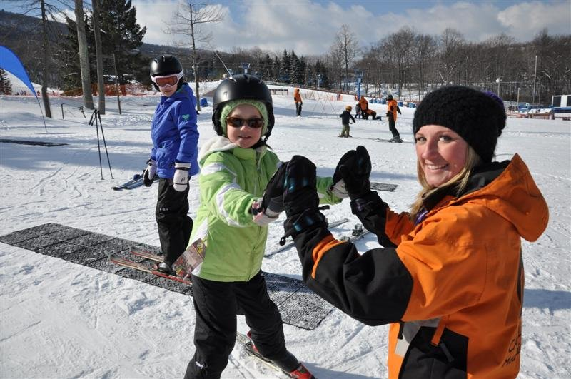 Young skiers getting the feel for sliding on snow. - ©Camelback Mountain Resort