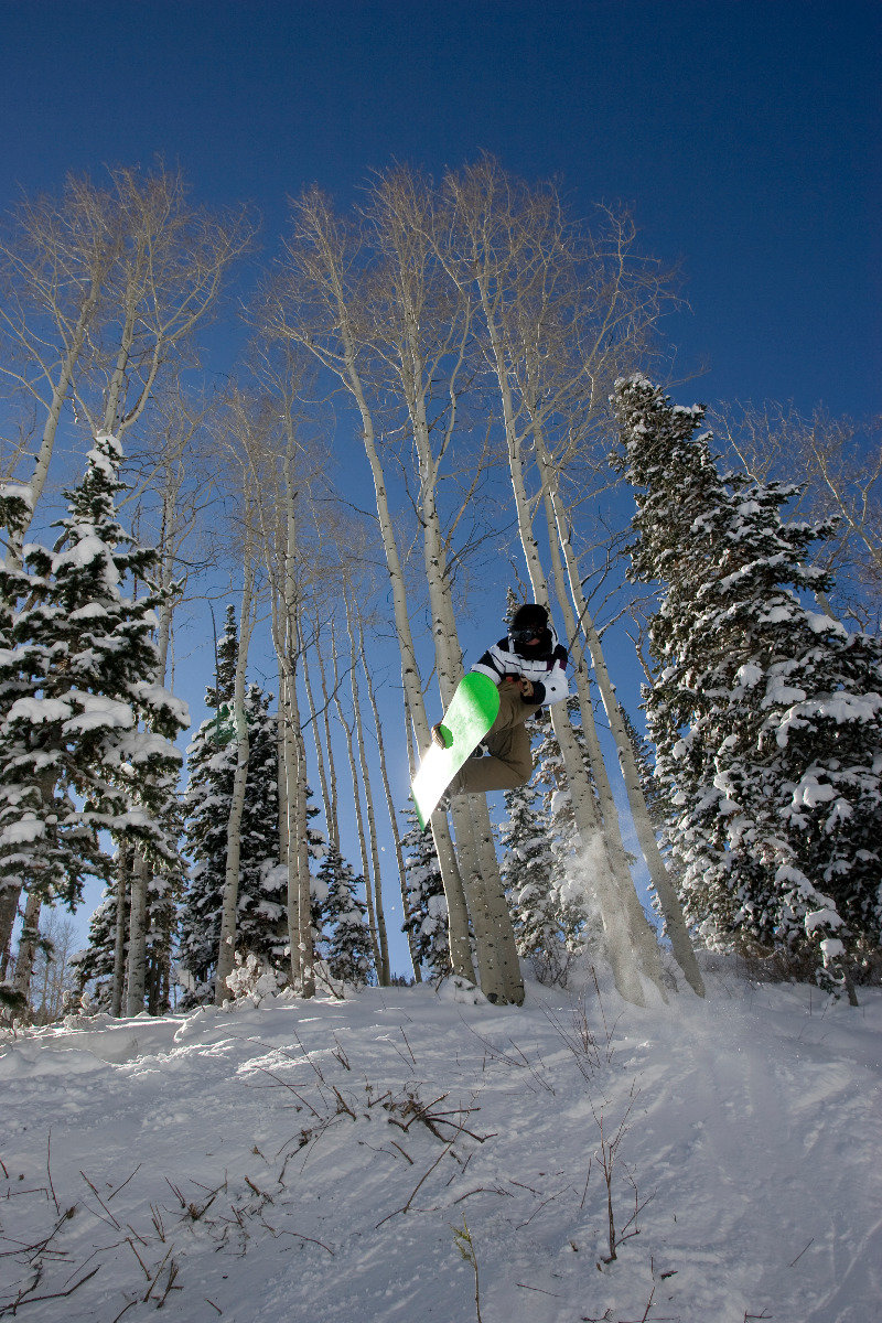 Snowboarders catch some air during Gnu, Guts & Glory freeride event at Canyons Resort, Mar. 16. - © Justin Olsen