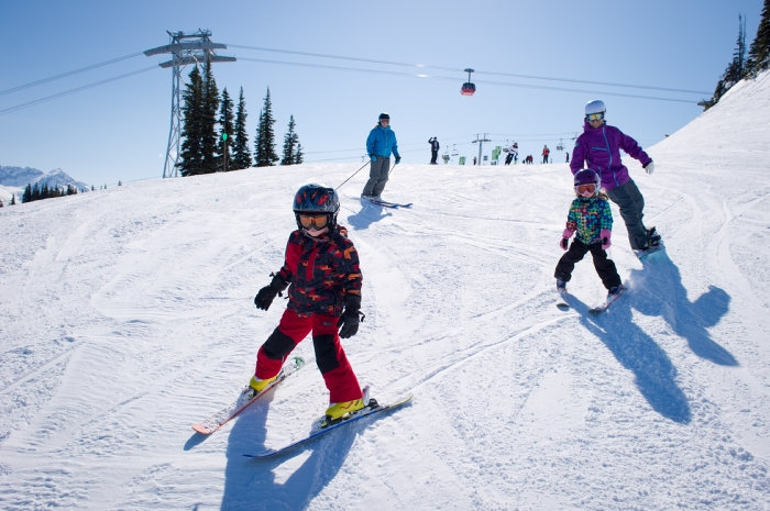 A family skis together on Whistler Mountain.  - © Mike Crane/Tourism Whistler