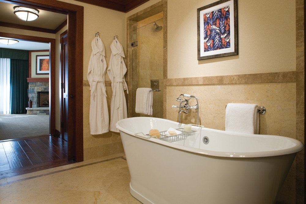 The guest bathroom in a suite at the Four Seasons Vail. - © Four Seasons Vail Resort & Spa