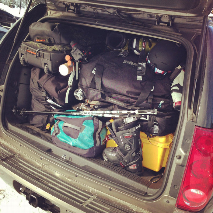 Traveling with ski gear can be tough if you plan to take a road trip. We've found it's best to put the things you'll need every day within quick reach and stash everything else. One trick is to keep a jacket, extra pair of socks and possibly a pair of pants near the seat with you. This way you won't have to dig through your bags if you need to change.  - ©Tim Shisler