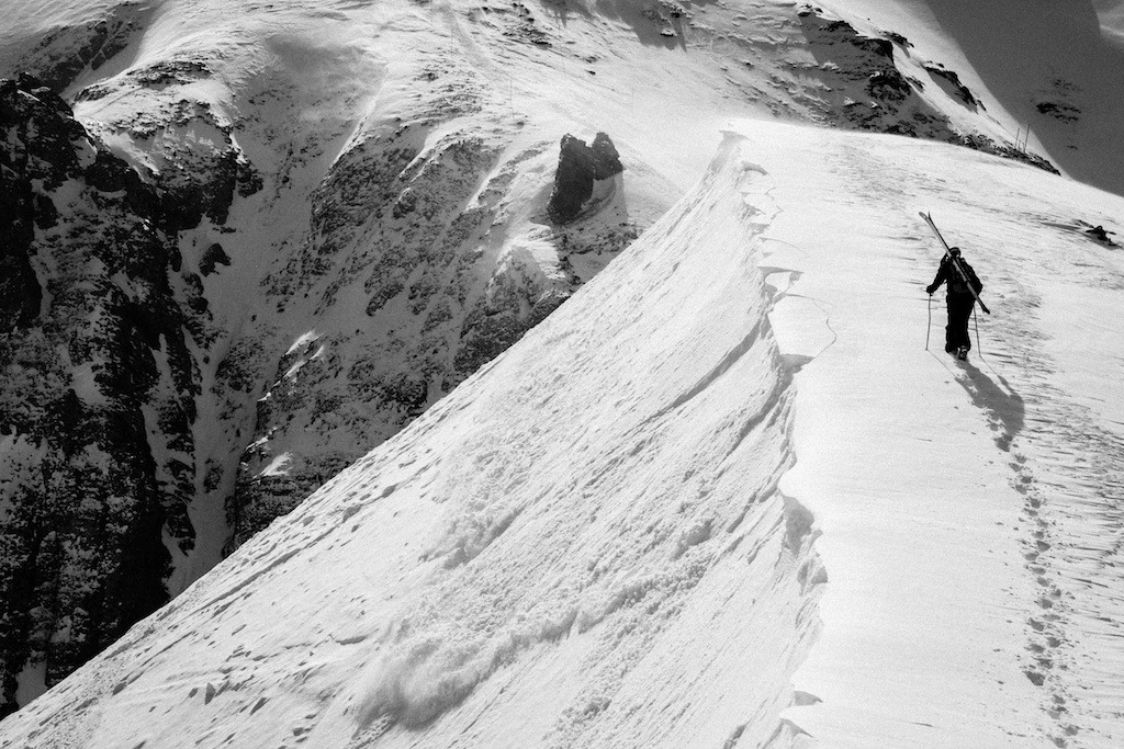 A tender wind slab breaks away as Herb Manning hikes for some turns at Telluride. - © Liam Doran