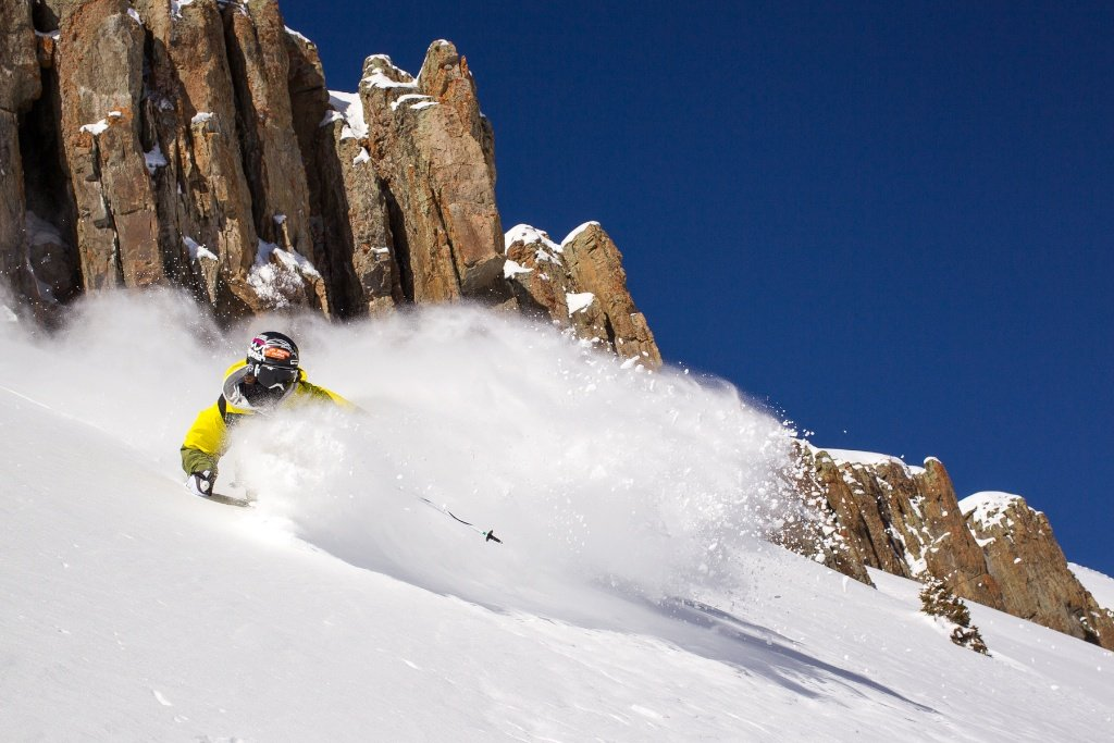 Aidan Sheahan sprays some powder at Irwin Cat Skiing. - © Jeff Cricco
