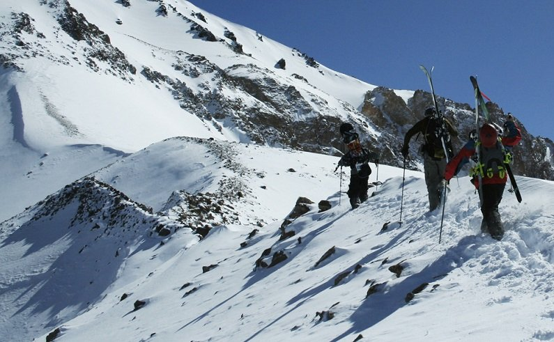 Three skiers hike for their turns in Portillo, Chile. - © Ski Portillo