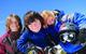 Kids dressed in ski gear