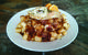 Fresh Tracks Café's breakfast poutine, famed for being just what the doctor ordered after a long night out. - © Fresh Tracks Café