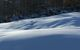 A scenic view of Whiteface, New York covered in snow