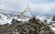 Tibetan prayer flags at the top of Kachina Peak. - © Donny O'Neill