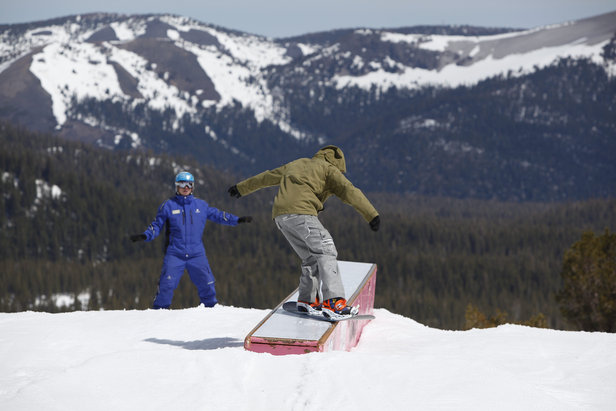 An instructor coaches a snowboarder learning terrain park features at Mammoth Mountain.  - © Peter Morning/MMSA