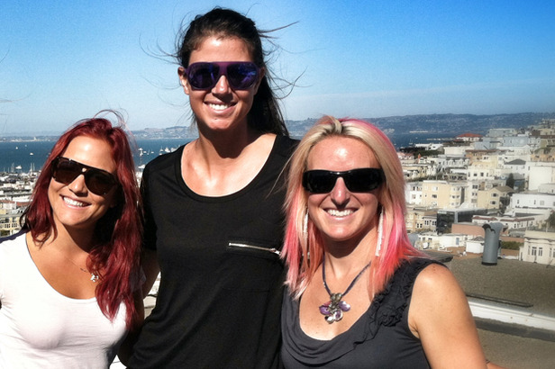 Olenick (in the middle) took in the Blue Angels air show from a rooftop with Elena Hight (left) and Shannon Bahrke (right). Photo by Jordan Orman.