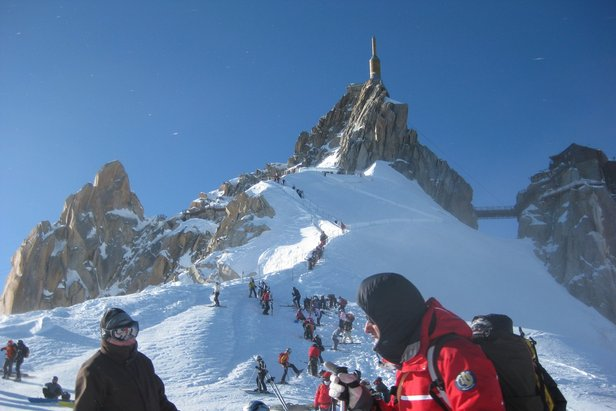 Making the 2800m vertical ascent up the Aiguille du Midi before skiing the Vallee Blanche
