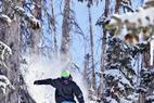 A skier shows his skill at Brian Head Resort. - A skier shows his