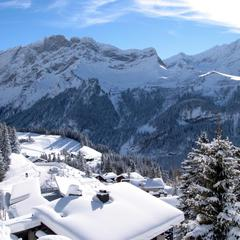 Snow-covered rooftops in Villars-Gryon, Switzerland