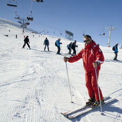 Ski instructor demonstrating turns in Claviere, Italy - ©James Young