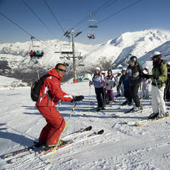 Ski instructor teaching a group the all-important