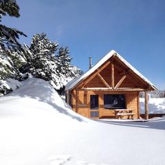 chalet bois vacances au ski Huttopia - © Huttopia / R. Etienne