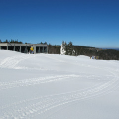 Snowmaking piles awaiting a groomer. Photo Courtesy of Snowshoe Mountain Resort.