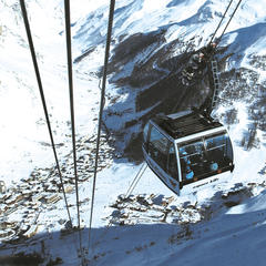 Taking the cable car up from Val d'Isere to the snowsure Espace Killy ski area