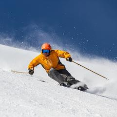Former World Cup Alpine Ski Racer Erik Schlopy rips up a groomer at Canyons in Park City, Utah.